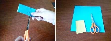 Из синей цветной бумаги подготовьте прямоугольник со сторонами 6 и 3 см. Далее сложите его пополам. Нарисуйте на нем контуры штанов для миньона, вырежьте по намеченной линии. Раскрыв деталь, мы получаем джинсовые штанишки для нашей поделки.