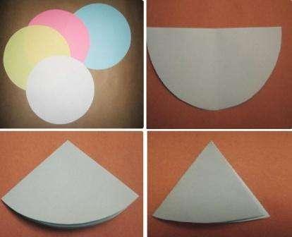 Можно попробовать вырезать объемные снежинки не из треугольников, а из кругов, которые легко начертить на бумаге с помощью циркуля.
